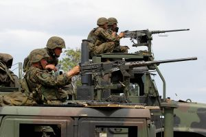 U.S. Marines fire pintle-mounted M-2 HB (heavy barrel) machine guns.